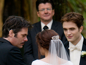 Bella's father Charlie gives her away to Edward during their wedding in The Twilight Saga: Breaking Dawn - Part 1.